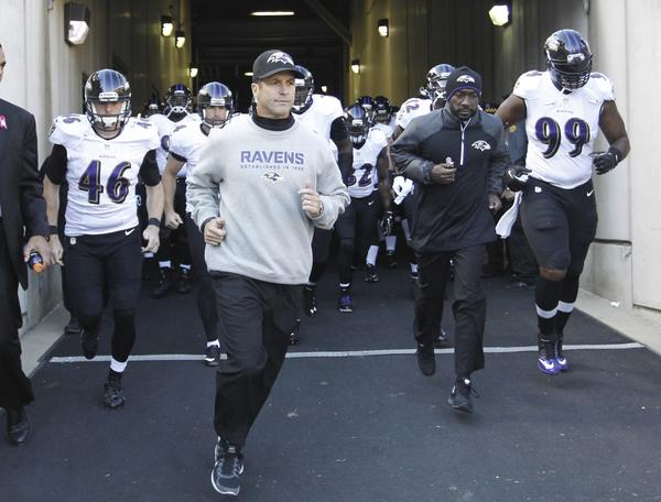 Ravens coach John Harbaugh leads his team out before they faced the Pittsburgh Steelers in October.