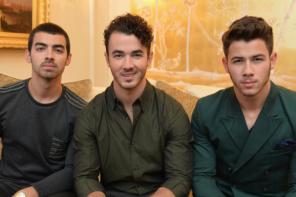 (L-R) Joe Jonas, Kevin Jonas and Nick Jonas of the Jonas Brothers attend the Mercedes-Benz Star Lounge during Mercedes-Benz Fashion Week Spring 2014.