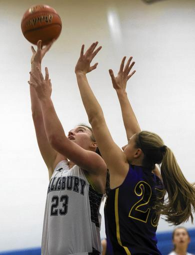 Salisbury's Meagan Eripret shoots as Palisades' Joey Noonan defends in a Colonial League game at Salisbury on Thursday.