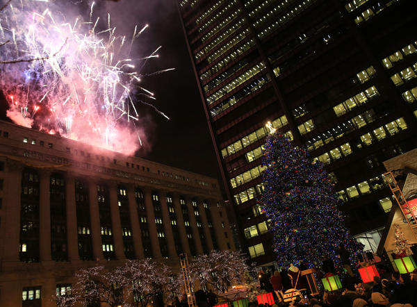 Fireworks are part of the lighting ceremony for the Christmas tree at Daley Plaza.