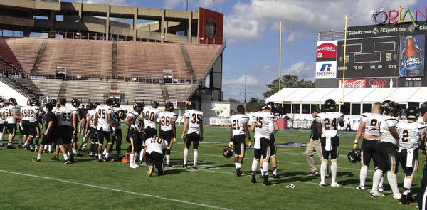 American Heritage goes through warmups in the Citrus Bowl prior to kickoff against Clay in Class 5A state title game. Photo Melissa Bosem