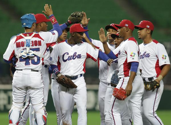 Cuba's players reacts after defeating China at their World Baseball Classic (WBC) qualifying first round game in Fukuoka, southern Japan March 4, 2013.