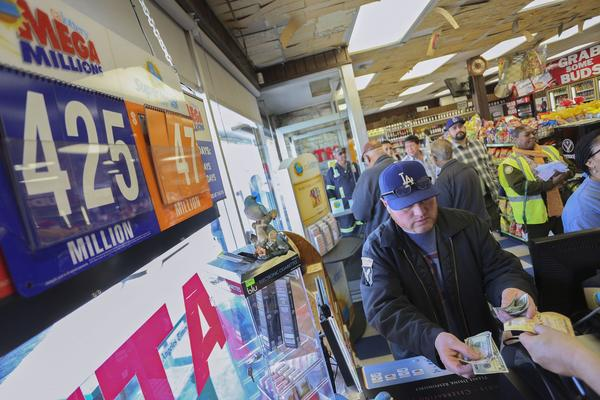 A man Friday buys Mega Millions lottery tickets at Bluebird Liquor in Hawthorne, Calif. (Jonathan Alcorn, Reuters)