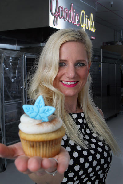 Chef-Owner Annette Starbuck, at Goodie Girls Cupcakes, holds a cinnamon roll cupcake in La Cañada Flintridge on Thursday, Dec. 12, 2013.