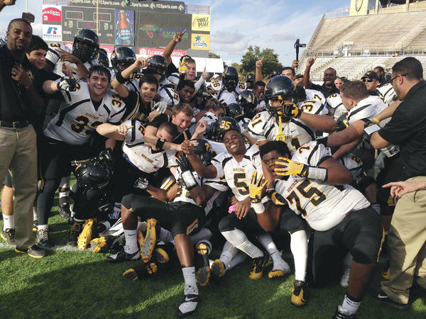 American Heritage players celebrate winning state football title 66-8 over Clay in Class 5A title game in the Citrus Bowl in Orlando.