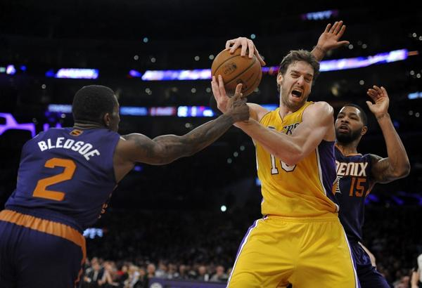 The Phoenix Suns' Eric Bledsoe, left, and Marcus Morris guard the Lakers' Pau Gasol in a game Tuesday.