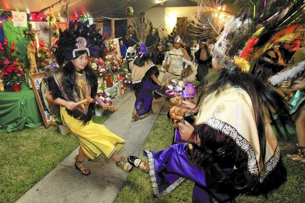 Mexico Lindo dancers of Huntington Beach perform in celebration of Our Lady of Guadalupe on Wednesday.