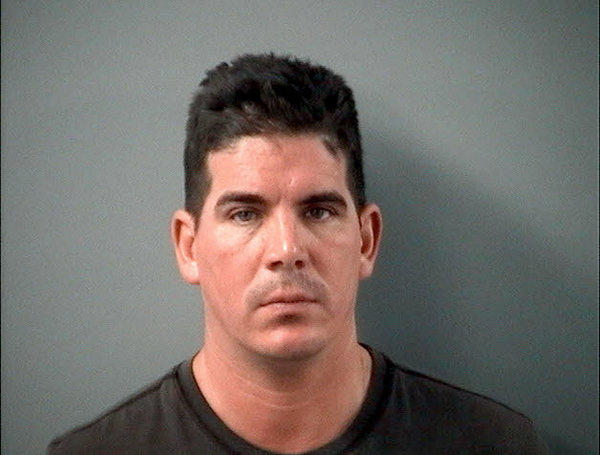 Eric M. Anderson of Niles, IL, who was arrested by the Crystal Lake Police Department on Dec. 8th, 2013 for two counts of Harassment by Electronic Device.