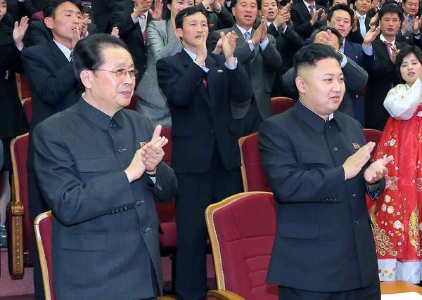 North Korean leader Kim Jong Un (right) and his uncle Jang Song Taek are seen last April celebrating the 101st anniversary of Kim Il Sung's birth. The North Korean state news agency reported last week that Jang had been executed.