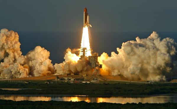 Shuttle Atlantis lifts off into space