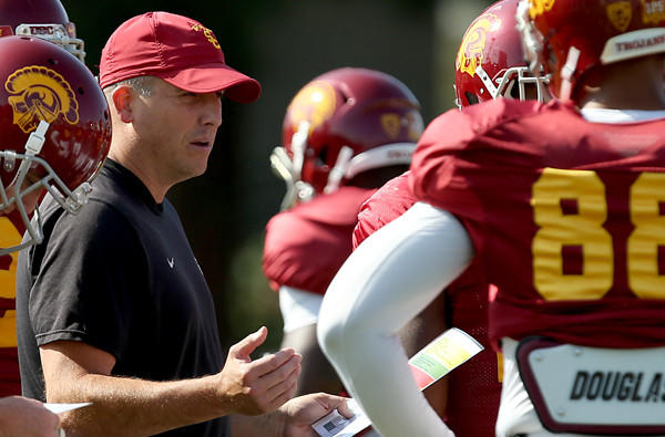USC offensive coordinator Clay Helton is the second interim coach for the Trojans this season.