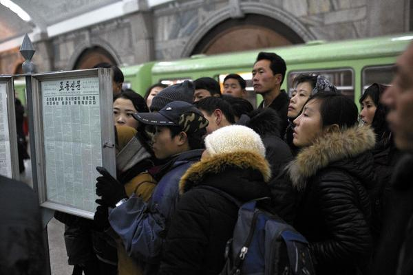 Subway commuters in Pyongyang, North Korea, read the news of Jang Song Taek's execution. More executions of older government officials are expected.