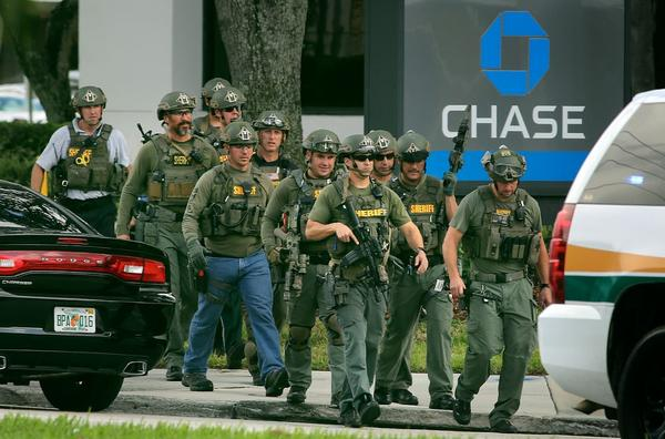 A bank robbery suspect was in a Chase branch, claiming to have a bomb strapped to his chest, the Broward Sheriffs Office said.