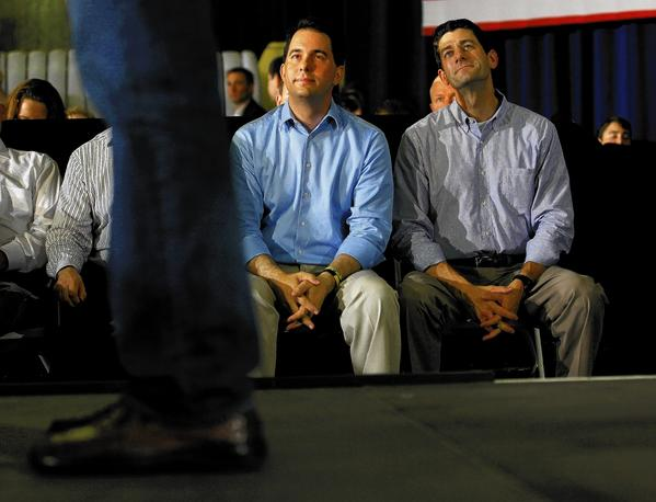 Wisconsin Gov. Scott Walker, left, and Rep. Paul Ryan appear together at a campaign event for former presidential candidate Mitt Romney in June 2012. Walker and Ryan are both possible contestants in the 2016 presidential election.