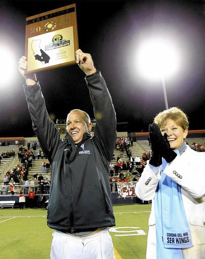 Corona del Mar High Coach Scott Meyer, left, standing next to Principal Kathy Scott, has led the Sea Kings to a 38-4 overall record and 14-1 in league, claiming two league titles and three CIF section titles in his three years.