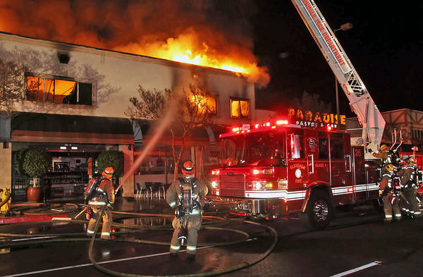 Glendale and Burbank firefighters battle a three-alarm fire at Paradise Pastry at 1818 Glenoaks Boulevard early Saturday, Dec. 14, 2013.