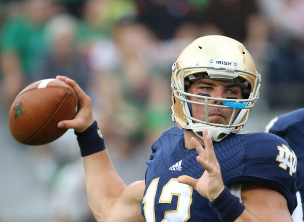 Notre Dame's Andrew Hendrix (12) warms up as teammate Tommy Rees (11) watches before a game against Temple.