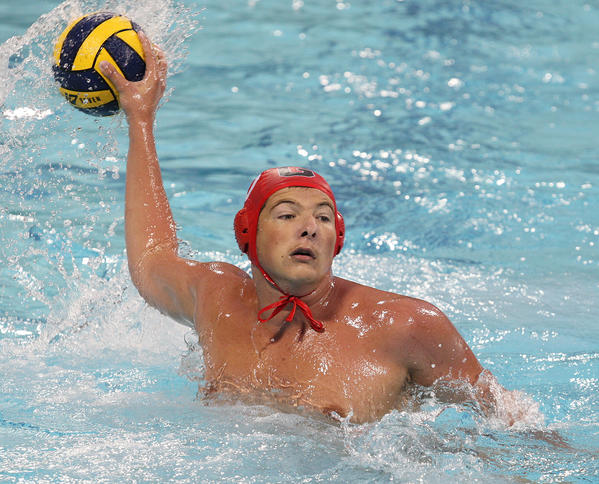 Glendale's Arman Momdzyan (10) fakes a shot and passes for an assist against Burbank in a Pacific League boys water polo first round playoff at Burbank High School on Tuesday, October 29, 2013.