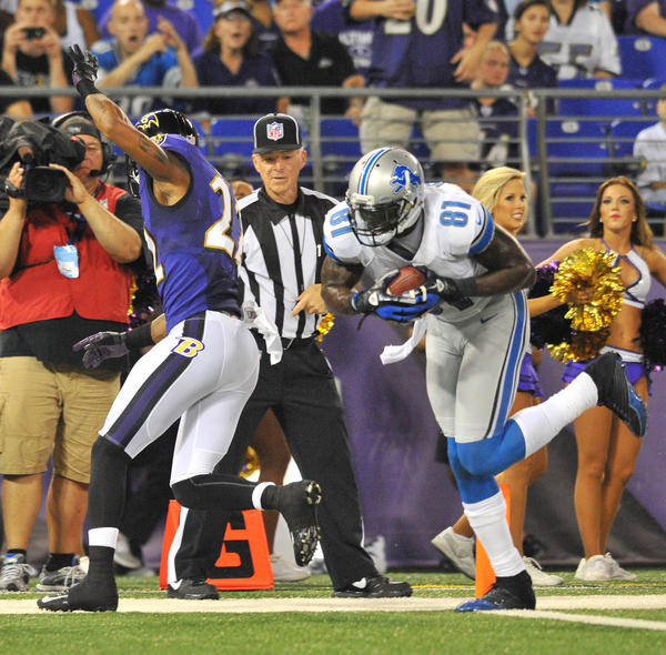 Detroit's Calvin Johnson walks into the end zone after beating the Ravens' Jimmy Smith for a touchdown in a preseason game last year.