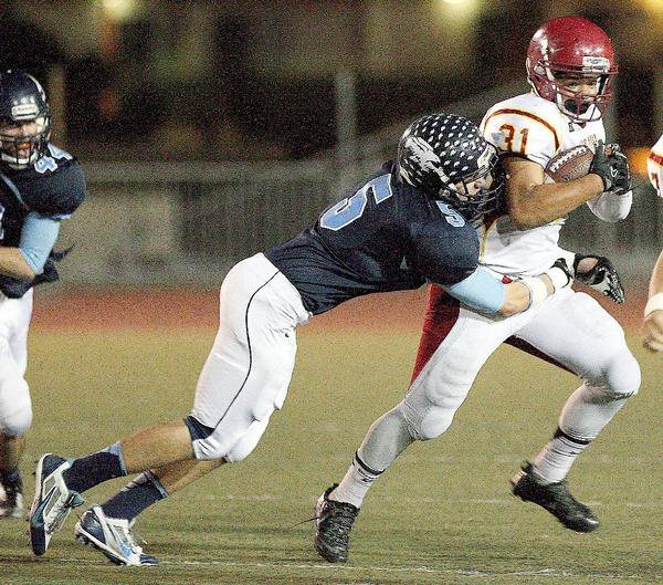 Crescenta Valley High linebacker Austin Brines is shown here taking down Arcadia's Joshua Benson during a Pacific League game on Nov. 7. Brines was lauded for his efforts this season by being named to the league's first-team defense. (Roger Wilson/File Photo)