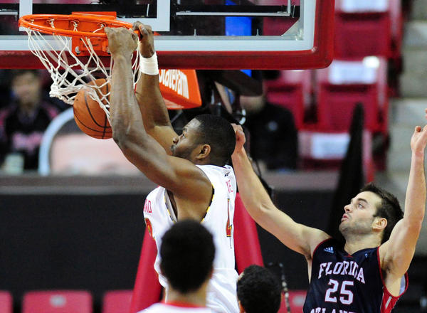 Maryland's Shaquille Cleare dunks the ball as Florida Atlantic's Pablo Bertone can only watch in Comcast Center.