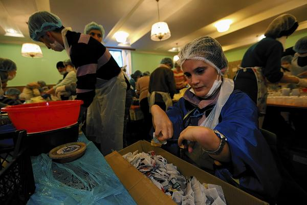 "Liza Shaposhnik, who has cerebral palsy, works in the kitchen of the opposition-occupied Trade Unions building in Kiev. Shaposhnik, who initially traveled to the capital from the Donetsk region in search of work, says she feels ""reborn"" by her daily efforts aiding the opposition cause."