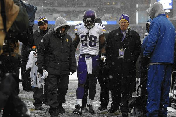 BALTIMORE, MD - DECEMBER 08: Running back Adrian Peterson #28 of the Minnesota is taken off the field after being injured during the game against the Baltimore Ravens at M & T Bank Stadium on December 8, 2013 in Baltimore, Maryland.