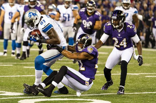 Detroit Lions wide receiver Calvin Johnson is dragged down by Ravens cornerback Jimmy Smith during a preseason game last year.