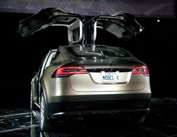 Tesla Motors Inc.'s Model X vehicle when it was unveiled at Tesla's design studio in Hawthorne in February 2012. Production is expected to begin next year. In early 2015, the company plans to introduce its next model, a high-volume car starting around $40,000.