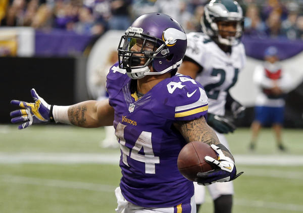 Vikings running back Matt Asiata celebrates his touchdown against the Eagles in the fourth quarter.