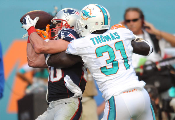 Michael Thomas of the Miami Dolphins knocks the ball away from Danny Amendola near the endzone on the last series of the game for New England.