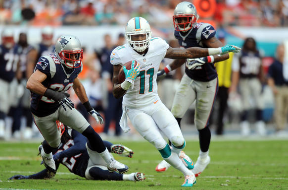 Mike Wallace of the Miami Dolphins scores a touchdown just before the half against the Patriots on Dec. 14 in Miami.