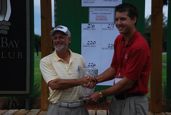 Doug Hanzel, left, receives the trophy for winning the Dixie Senior Amateur from tournament director Ben Derauf.