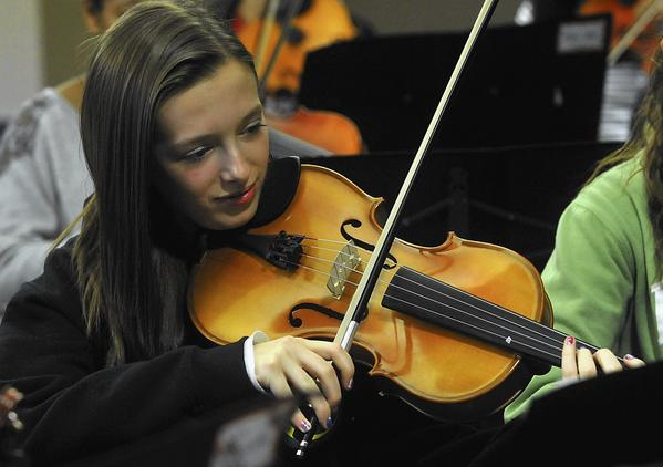 Jenny Leader, 14, of Macungie, plays viola during rehearsal with the Junior String Philharmonic.