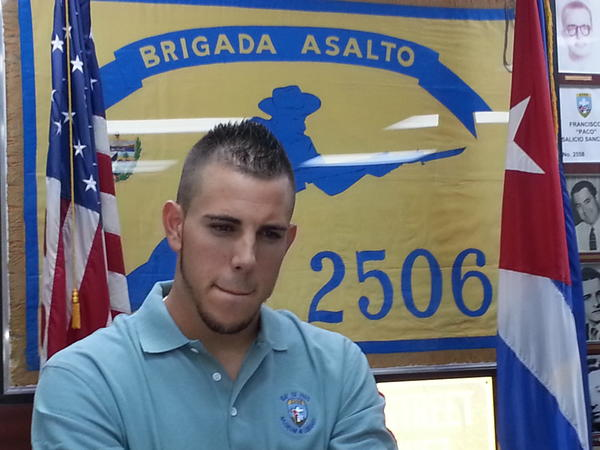 Miami Marlins pitcher Jose Fernandez, who escaped from Cuba at age 15, on Thursday at the Museum and Library of the 2506 Assault Brigade in Little Havana, received an education about the Bay of Pigs invasion from some of the combatants who survived the experience. staff photo/Juan Rodriguez