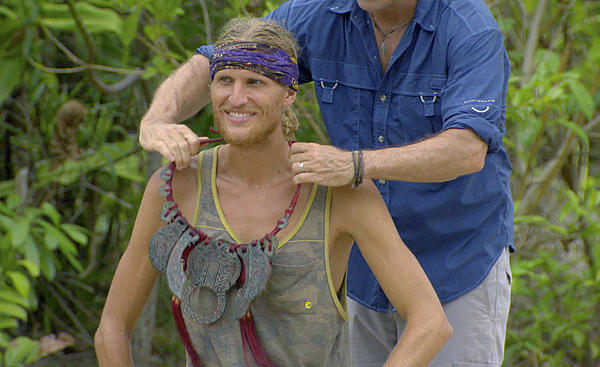 "Jeff Probst awards Tyson Apolstol with the Immunity Necklace on ""Survivor: Blood vs. Water."""
