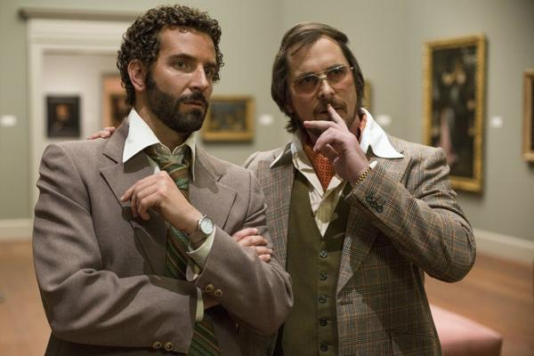 "David O. Russell's ""American Hustle,"" with Bradley Cooper, left, and Christian Bale, received 13 Critics' Choice Movie Awards nominations."