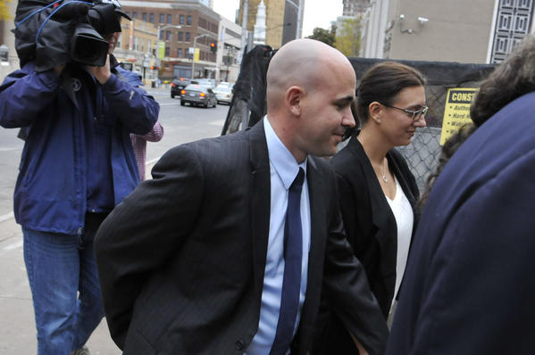 Former East Haven police officer Jason Zullo enters U.S. District Court in Hartford in October 2012.