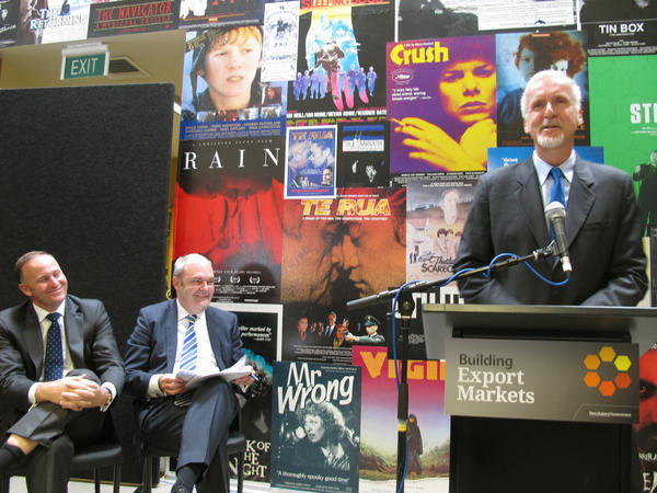 "New Zealand Prime Minister John Key, left, and Economic Development Minister Steven Joyce listen as director James Cameron announces details about  three sequels to his 2009 blockbuster sci-fi movie ""Avatar."""