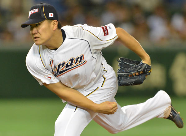 Japan's Masahiro Tanaka throws against the Netherlands during the fifth inning of the second-round Pool 1 game in the World Baseball Classic tournament at Tokyo Dome on March 12, 2013.
