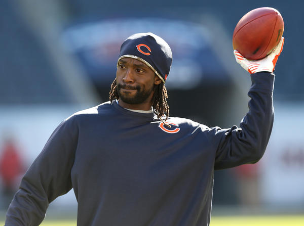 Chicago Bears cornerback Charles Tillman throws a left handed pass while warming up before a game against the Detroit Lions.