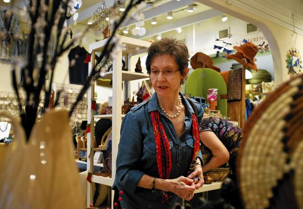 Regent Weber shops inside of Ten Thousand Villages on Park Avenue in Winter Park on December 11, 2013. Central Florida shops such as Market Colors, Credo and Ten Thousand Villages specialize in gifts with a social conscience.