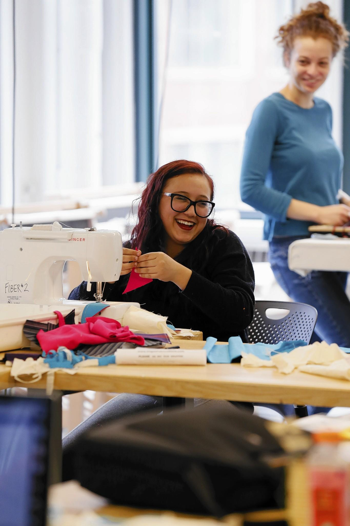 Adriana Alamillo, 20, of Mexico City, jokes with classmates last month in her Introduction to Fibers class at the School of the Art Institute of Chicago, which has 11 percent international students.