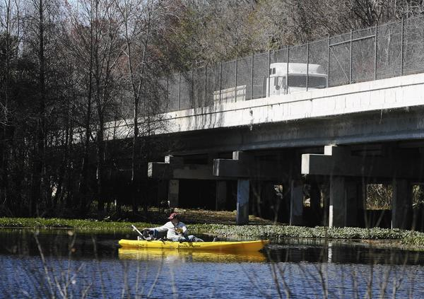 Ryan Leach fishes the Wekiva with his kayak near the SR 46 bridge Wednesday.