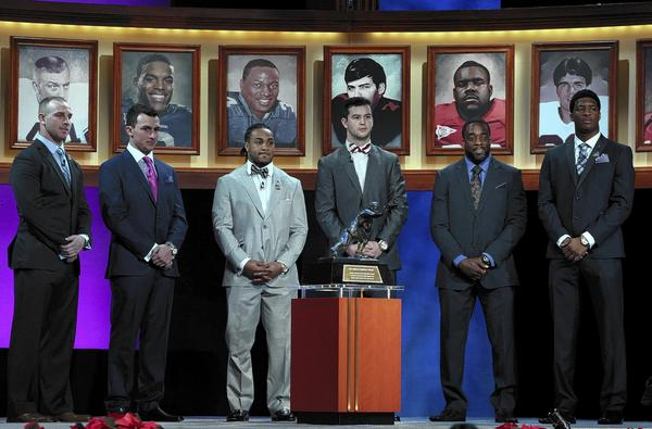 Heisman Trophy finalists (L-R) Jordan Lynch, quarterback of Northern Illinios, Johnny Manziel, quarterback of Texas A&M, Tre Mason, running back for Auburn, AJ McCarron quarterback of Alabama, Andre Williams, running back of Boston College, and Jameis Winston, quarterback of Florida State, pose with the trophy during the 2013 Heisman Trophy Presentation at the Best Buy Theater in New York City.