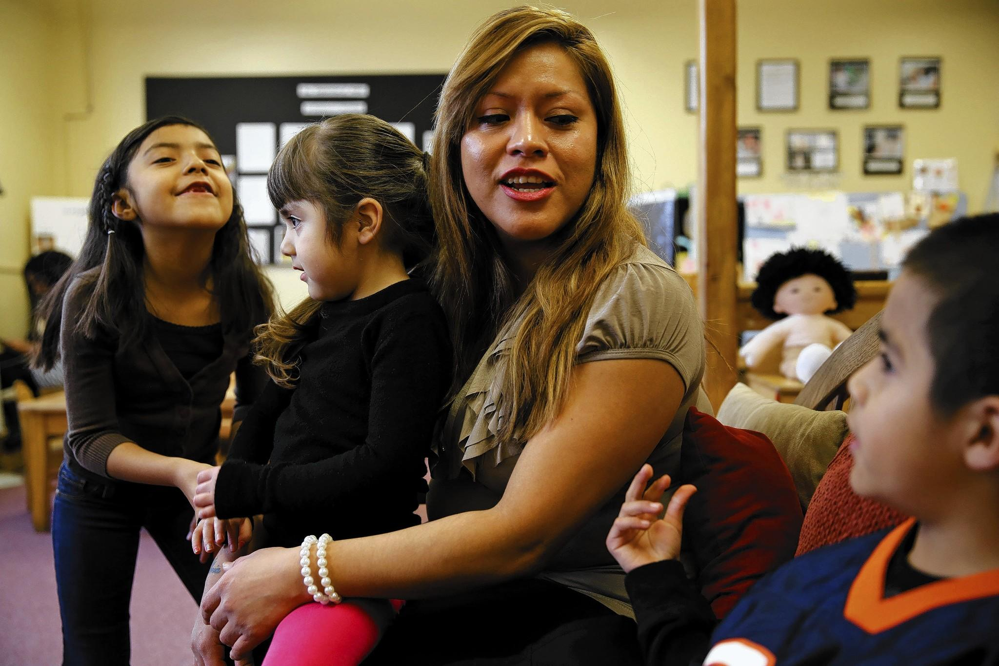 Gloria Cruz, 32, said she struggles to buy winter clothes for her three children, who get subsidized care at Chicago Commons' Guadalupano Family Center in Pilsen.