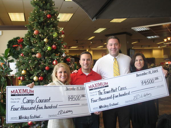 "The first ""WeHa Whiskey Fest"" raised $4,500 each for Camp Courant and The Town That Cares Fund. Pictured at the check presentation, from left, are: McKinley Albert, director of development for Camp Courant; Maximum Beverage Managing Partner Seth Goldstein; Camp Courant Executive Director and CEO Josh Reese; and Suzanne M. Oslander, community partnerships manager for the West Hartford Department of Human and Leisure Services, which oversees the Town That Cares Fund."