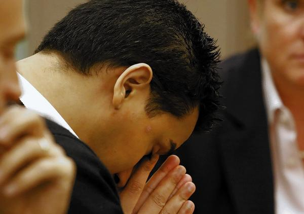 Iftekhar Murtaza bows his head before an Orange county jury recommended that he receive the death penalty for killing the father and sister of his former girlfriend.