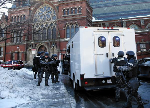 SWAT team officers arrive at a building at Harvard University in Cambridge, Mass. Four buildings were evacuated after campus police received a report that explosives may have been put inside.