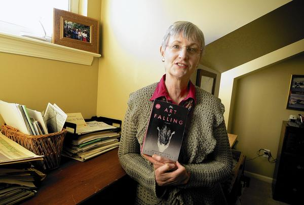Author Kathryn Craft talks about her novel, 'The Art of Falling,' in her study.